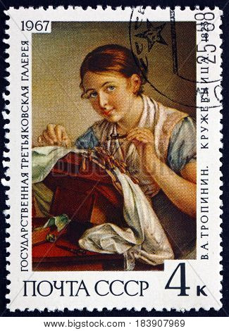 RUSSIA - CIRCA 1967: a stamp printed in Russia shows The Lacemaker Painting by V. A. Tropinin 1823 Russian Romantic Painter circa 1967
