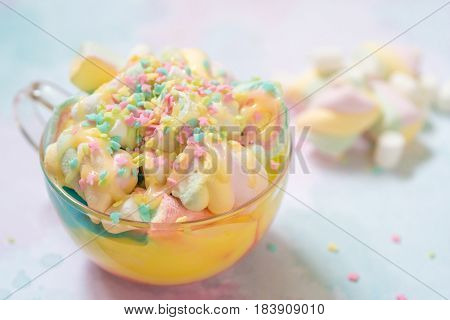 Unicorn food. Rainbow hot chocolate with colorful marshmallow on a table