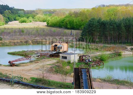 Sand Quarry, Conveyor Belts And Quarry Crane. Construction Industry. Horizontal  Photo