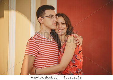 Beautiful Romantic Couple In Love. Happy Smiling Couple In Red Looking At Camera. Portrait Of A Youn