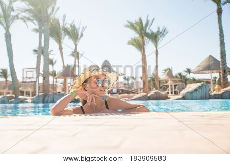 Beautiful Young Woman Relaxing In Spa Swimming Pool.