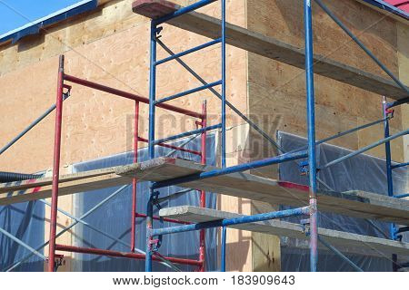scaffold close-up metal construction structure facade renovation repair