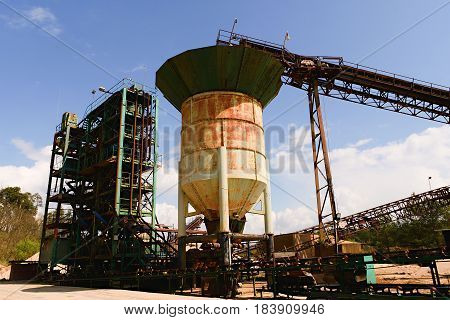 Quarry Aggregate With Heavy Duty Machinery. Construction Industry. Horizontal  Photo.