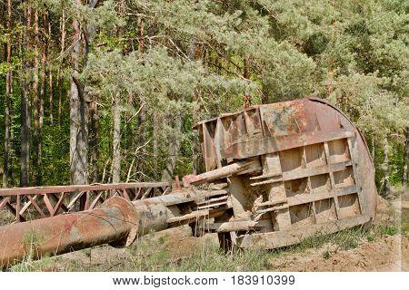 Abandoned Industrial Parts. Rusty Metall Equipment. Shovel Of Quarry Crane.