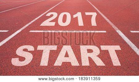 Word Start Written On An Asphalt Road