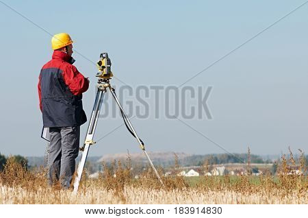 Geodesy. surveyor worker with theodolite