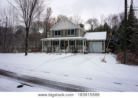 HARBOR SPRINGS, MICHIGAN / UNITED STATES - NOVEMBER 23, 2016: A home on West Fourth Street, after a November snowstorm.