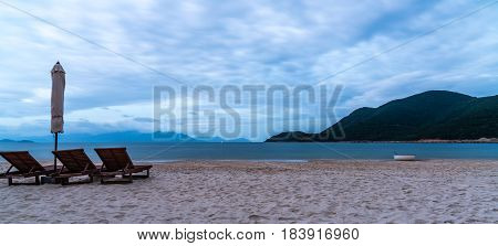beach mountain sea and Lounge chair, morning