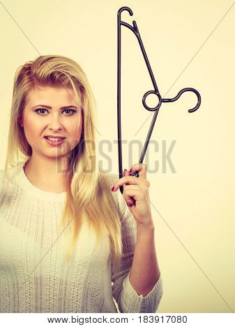 Blonde Woman Holding Clothes Hanger