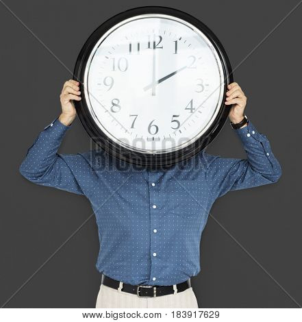 Man Holding Clock Covering Face