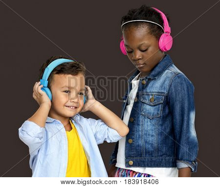 Kids enjoying listening to music with headphones
