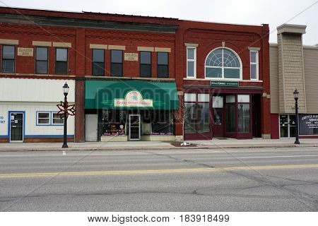 KALKASKA, MICHIGAN / UNITED STATES - NOVEMBER 27, 2016: Two of the principal businesses in downtown Kalkaska include the Cedar Street Sweets Bakery and Edward Jones Investments.