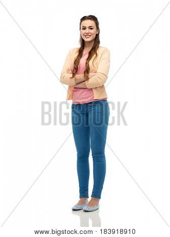 fashion, portrait and people concept - happy smiling young woman in cardigan and jeans