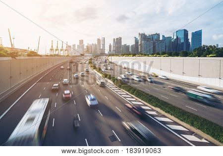 Busy Road And City Background During Rush Hour