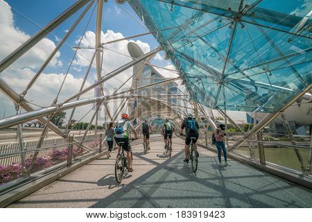 Cyclist Riding On Helix Bridge In Marina Bay, Singapore