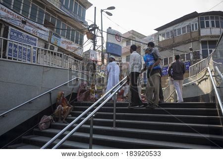 DELHI INDIA - JUL 25 : life of peole at entrance gate of delhi metro at hauz qazi chowk in chawri bazar this area is biggest wholesale market of delhi on july 25 2015 india