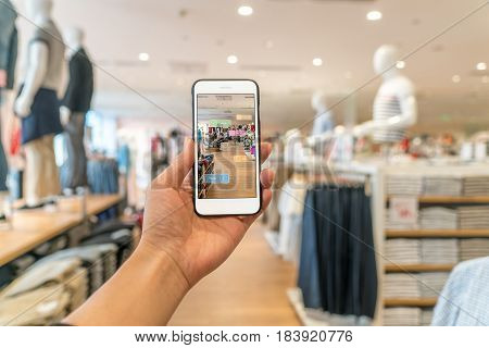 Augmented Reality Marketing . Hand Holding Smart Phone Use Ar Application To Check Information