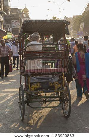 DELHI INDIA - JUN 6 : rickshaw driver in crowded of people at chandni chowk in old Delhi of Delhi on june 6 2015 india. rickshaw is three wheeler taxi of Delhi