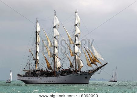 classic pirate-ship sailboat on the sea with cloudy background