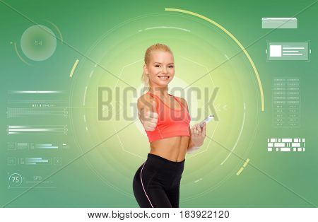 sport, fitness, technology, internet and healthcare - smiling sporty woman with smartphone showing thumbs up