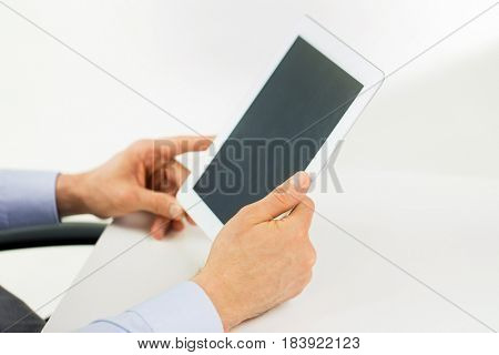 business, people and technology concept - businessman hands with tablet pc computer at office