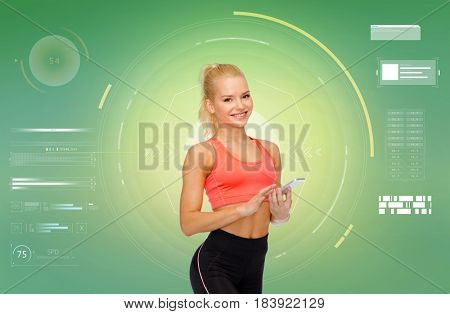 sport, fitness, technology and people concept - smiling sporty woman with smartphone over green background