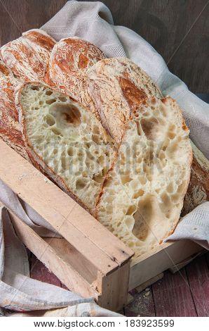 Freshly Baked Italian Ciabatta Bread In A Wooden Box. Dark Rustic Style.