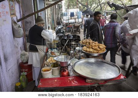 DELHI INDIA-DEC 20 : india street food stall in alley of chandni chowk. this area is in old delhi that is famous place of Delhi on december 20 2014 india