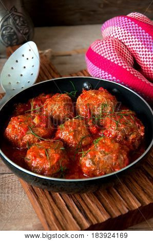 Homemade Roasted Beef Meatballs With Sour Tomato Sauce. Close Up And Rustic Style.