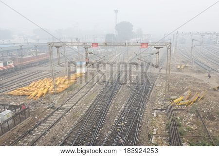 DELHI INDIA - DEC 27 : fog and winter scene of new delhi railway station. this station is large railway station of delhi on december 27 2014 india