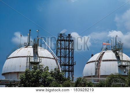 Gas storage spheres tank in refineryl plant on sky background.