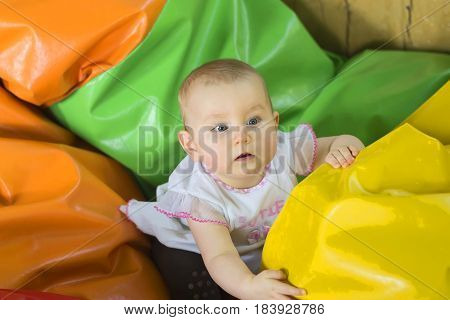 small remarkable active child, shows emotions In the children's room.