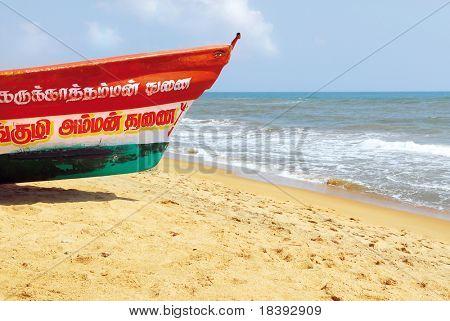 colorful fishing boat on beach of mahabalipuram, india