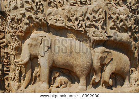elephants and people carved in stone wall hindu temple mahabalipuram, india