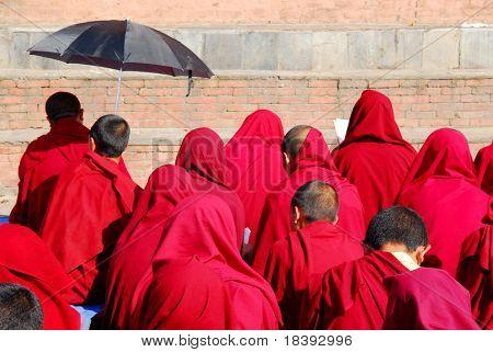 Buddhist monks praying at swayambhunath temple in Kathmandu, Nepal