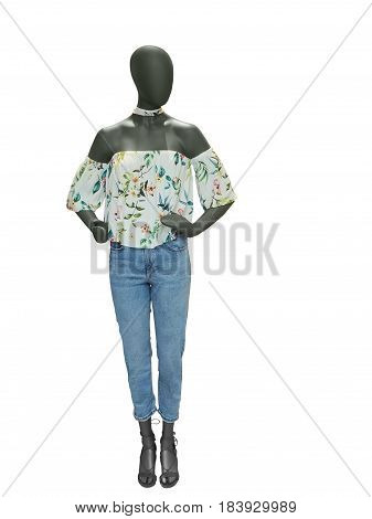 Full-length female mannequin dressed in top and blue jeans isolated on white background. No brand names or copyright objects.