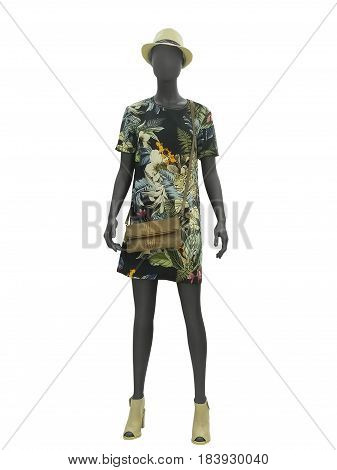 Full-length female mannequin in a floral print dress. No brand names or copyright objects.