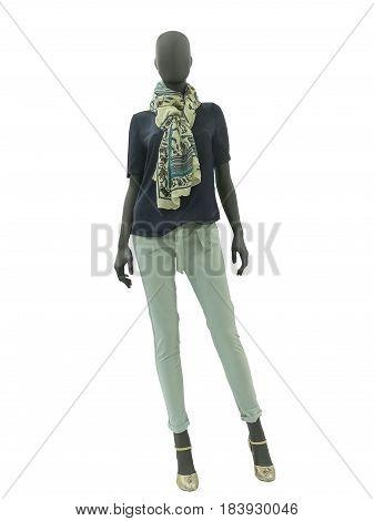 Full-length female mannequin dressed in fashionable clothes isolated on white background. No brand names or copyright objects.