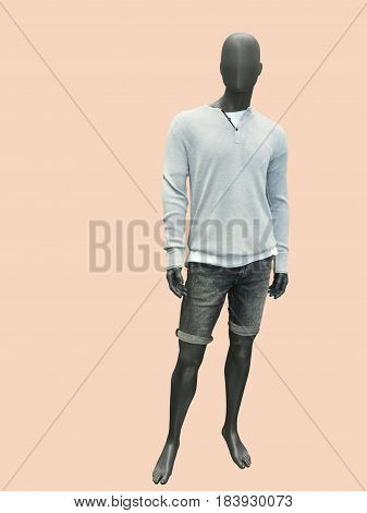 Full-length male mannequin dressed in sweater and shorts isolated. No brand names or copyright objects.