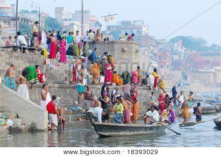 colorful hindu people bathing in the ganges river in varanasi