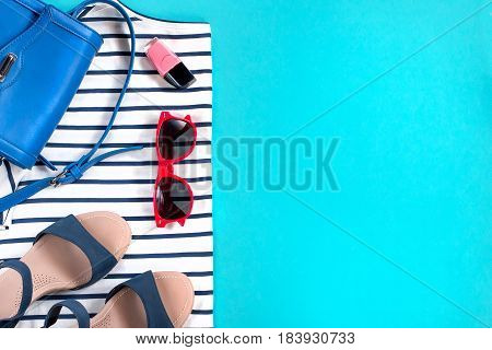 Female summer clothes collection, sea theme, copy space, top view