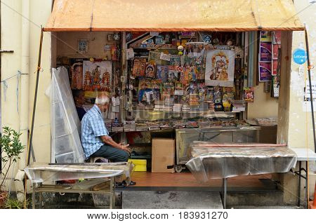 SINGAPORE- APR 09 2017: Owner of Indian magazines store along at the roadside of Little India in Singapore Little India is Singaporean neighborhood east of the Singapore River
