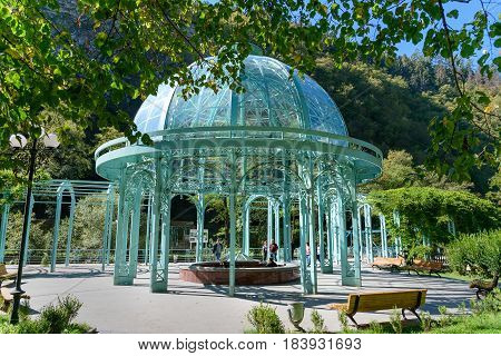 Borjomi Georgia - October 01 2016: Blue pavilion with hot source in Mineral water park