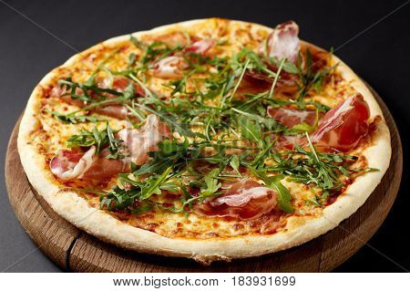 Hot Pizza Prosciutto On A Rustic Wooden Table.