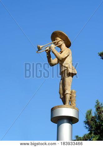 Statue Boy With Music Pipe In Batumi. Georgia