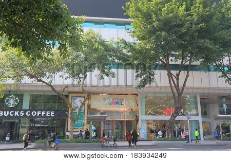 GUANGZHOU CHINA - NOVEMBER 12, 2016: Unidentified people visit Wmall. Wmall is a shopping mall in downtown Guangzhou.