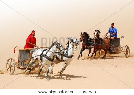Roman warriors racing with horses and chariots carts during Roman show in Jerash, Jordan