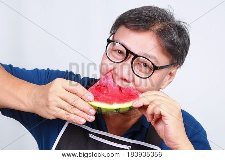 Men eat pieces of watermelon with sweet taste.