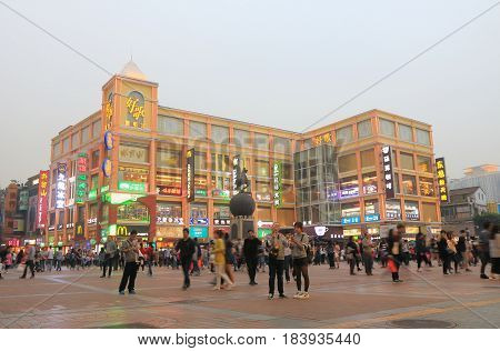 GUANGZHOU CHINA - NOVEMBER 12, 2016: Unidentified people visit Shangxiajiu pedestrian street. Shangxiajiu is the first business street in Guangzhou opened in 1995