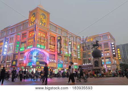 GUANGZHOU CHINA - NOVEMBER 12, 2016: Unidentified people visit Shangxiajiu pedestrian street. Shangxiajiu is the first business street in Guangzhou opened in 1998
